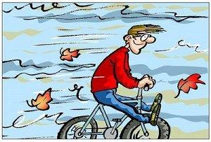 man op fiets in de storm